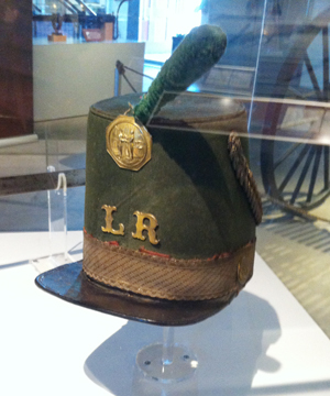"""Shako used by John Hunt Morgan's """"Lexington Rifles."""" This unit was organized in 1857 and was the first Kentucky unit to join the Confederacy. (Click photo for more info)"""
